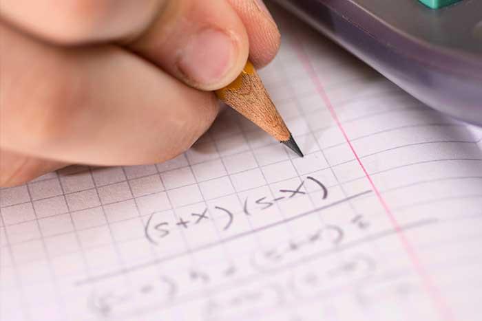 Closeup of a pencil working an algebra problem